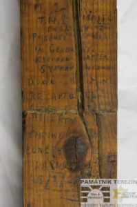 Part of a board from a cell of Terezín´s Police Prison bearing the English text written by Thomas Moles; Terezín Memorial, PT 8870