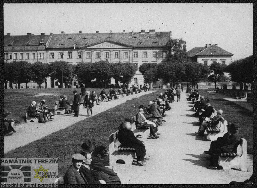 Prisoners on the benches at the Terezín square in the time of liberation, FAPT 4588