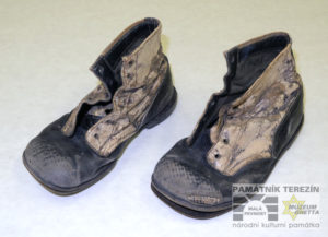 Children´s shoes worn in the Terezín Ghetto by Petr Dadák (born in 1942). He was deported to Terezín from Ostrava in March 1945 in a transport AE 6. He stayed in Terezín with his mother until the ghetto´s liberation, Terezin Memorial, PT 14298.